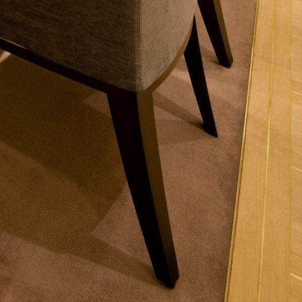 a refined transition strip is barely there putting the attention on the contrasting finish materials